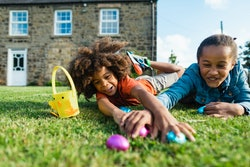 kids having an easter egg hunt in the backyard