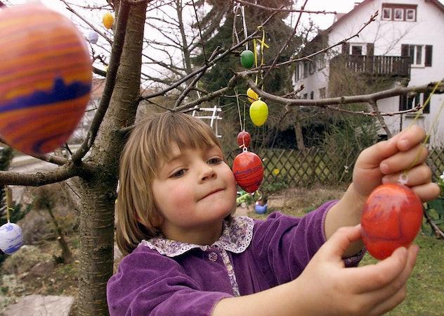 little girl hunt easter eggs