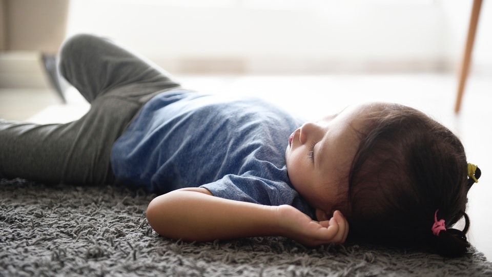 Toddlers sleeping on the floor really isn't a cause for concern, experts say.