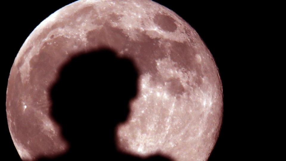Families can view April's super pink moon when it rises Tuesday night.