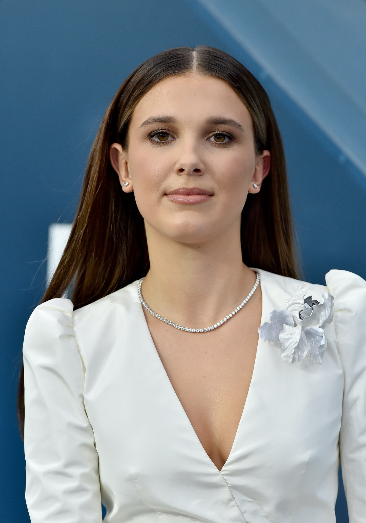 Millie Bobby Brown hits the red carpet in a white dress.