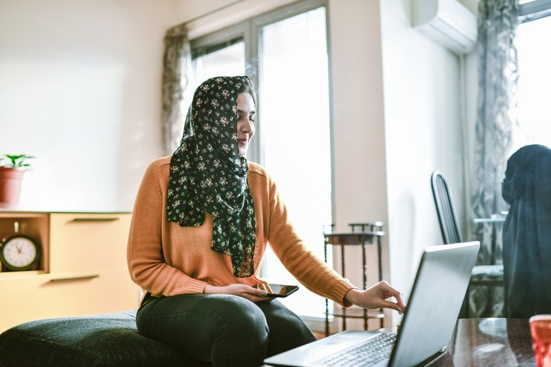 A woman uses zoom for a work meeting. If you use Zoom, you might be wondering if zoom is safe; a cybersecurity expert weighs in.