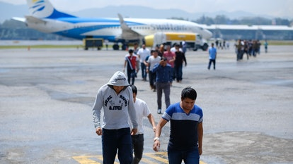 Guatemalans who were deported from the United States arrive at La Aurora International airport in Au...