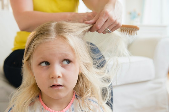 You can convince your child that brushing their hair isn't murder by using detangler and letting them pick out their own brush.