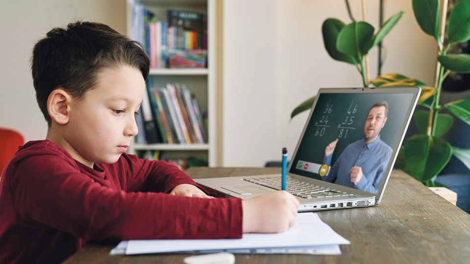 boy having online session with teacher