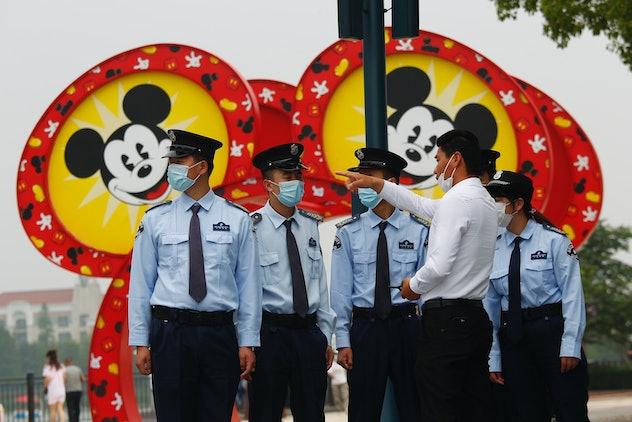 Security guards wear masks