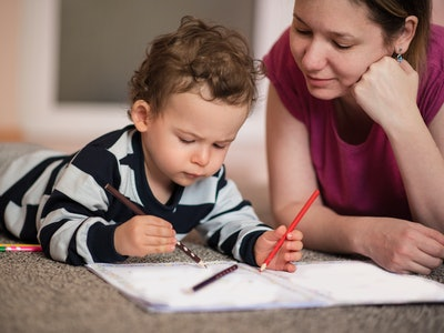 mom and little boy coloring in a coloring book