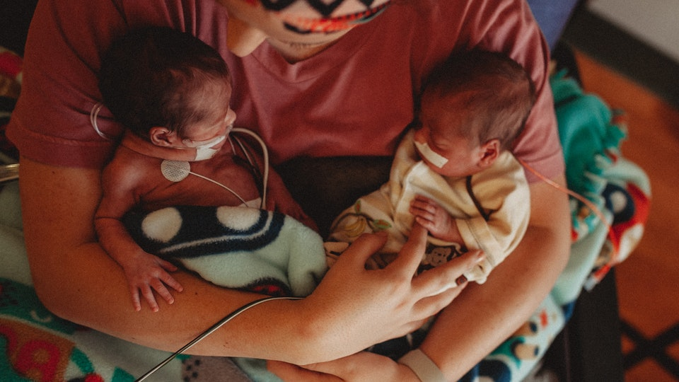 mom holding newborn twins