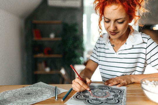 woman coloring in a printable coloring page