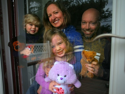 a family having a teddy bear scavenger hunt during quarantine