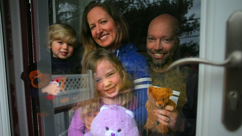 a family having a teddy bear scavenger hunt during quarantine