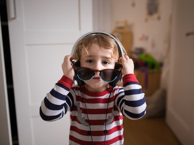 little boy wearing headphones and sunglasses
