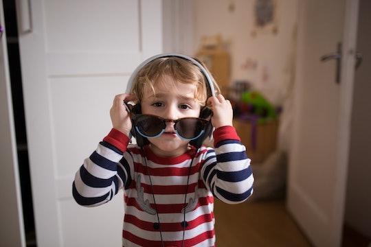 little boy wearing headphones and sunglasses