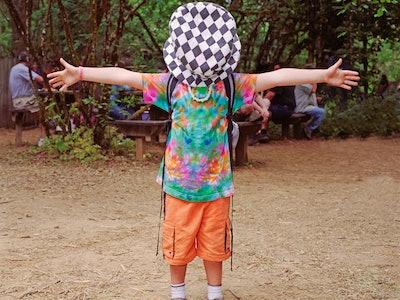 kid weaering tie dye shirt