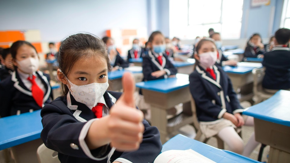 Photos from countries that have begun welcoming students back into classrooms provide a peek at what schools might look like post-pandemic in the United States.