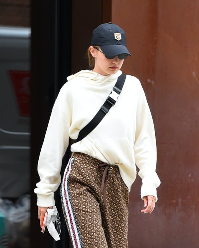 Gigi Hadid wearing a baseball hat.