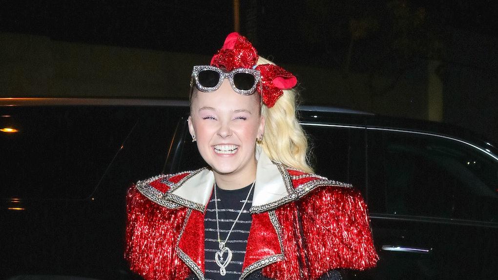 Jojo Siwa rocks a sparkly red outfit.