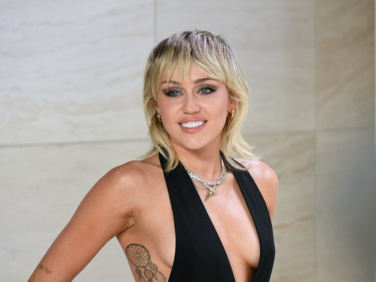 Miley Cyrus' new hair cut is a reimagining of a pixie cut and mullet blended together.