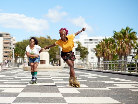 Two rollerskaters rollerskate down an empty block. Why Roller Skating Videos Are Trending On TikTok, according to Ana Coto and other rollerskaters on tiktok.