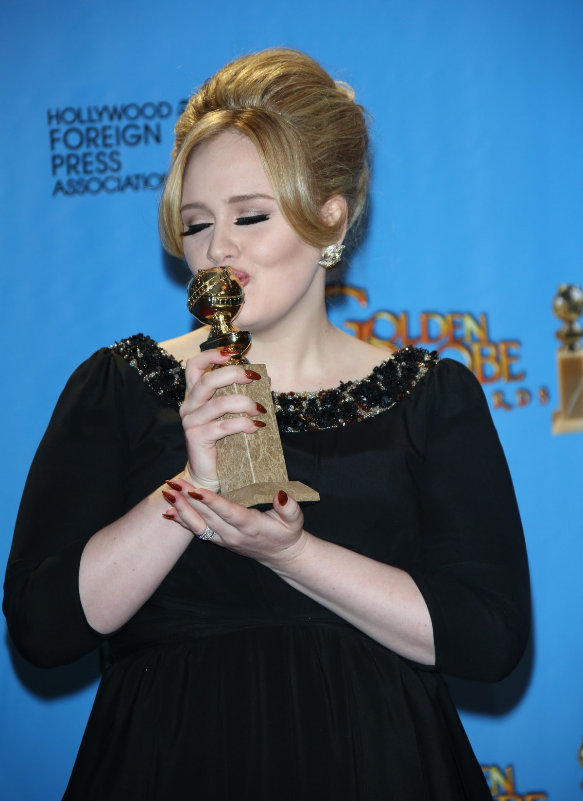 Adele poses with an award from the Hollywood Foreign Press Association.