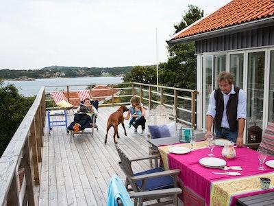 family on deck of beach house