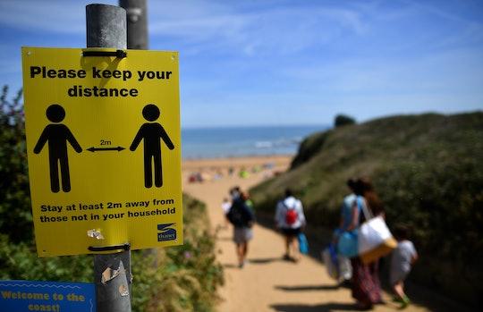 social distancing sign at beach