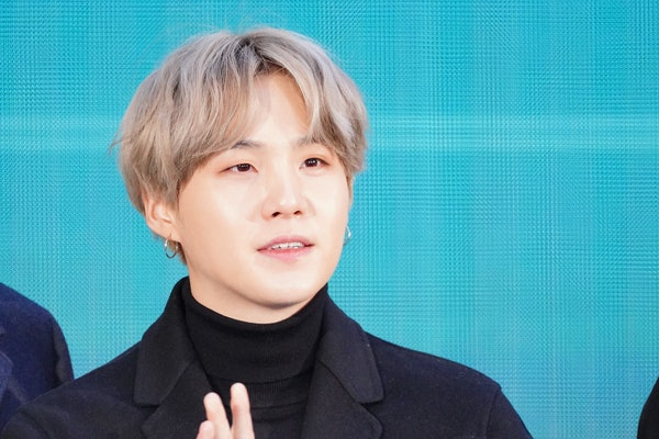 BTS' Suga waves to fans.