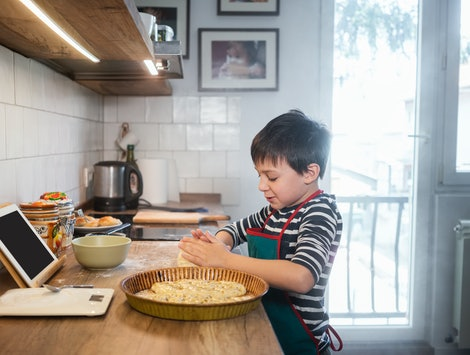 kid baking in front of tablet virtual camp