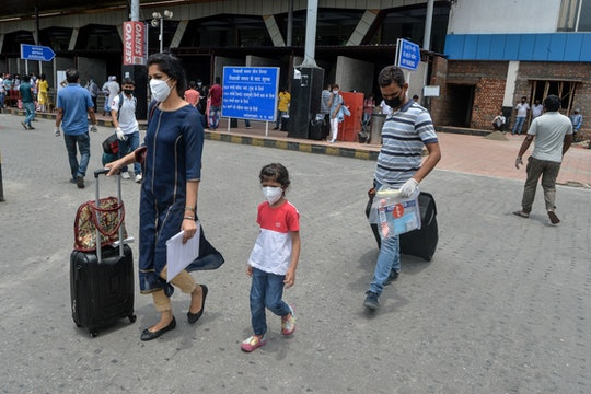family with masks at airport