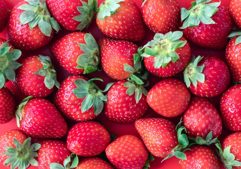A close up of strawberries. A viral TikTok video showed bugs coming out of strawberries - but the bugs were likely safe to eat, experts say.