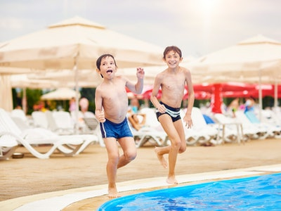two brothers about to jump in a pool