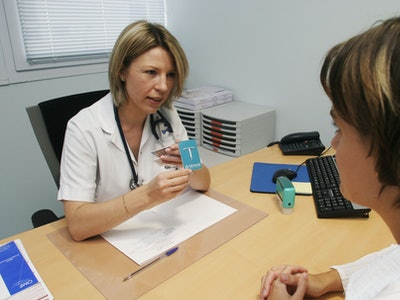 woman doctor explaining an IUD to a woman patient