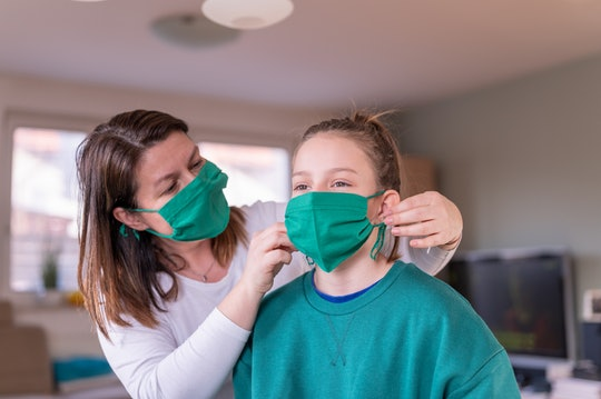 woman and daughter wearing cloth face masks