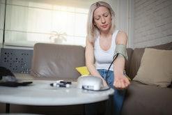 woman taking her blood pressure