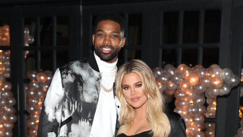 Khloe Kardashian and Tristan Thompson attend a party.