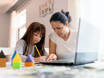 mom helping daughter with online arithmetic course