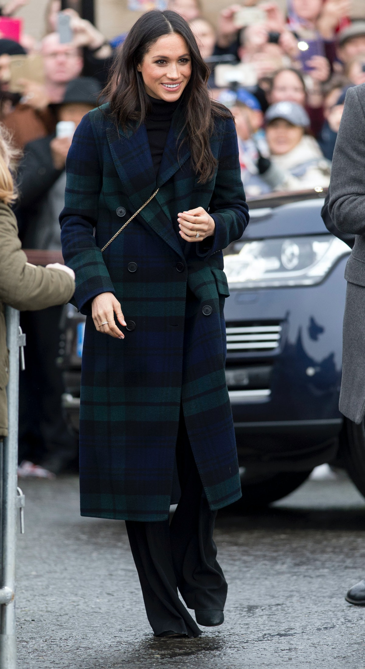 Meghan Markle dressed in a tartan plaid wool coat on a visit to Edinburgh in February 2018.
