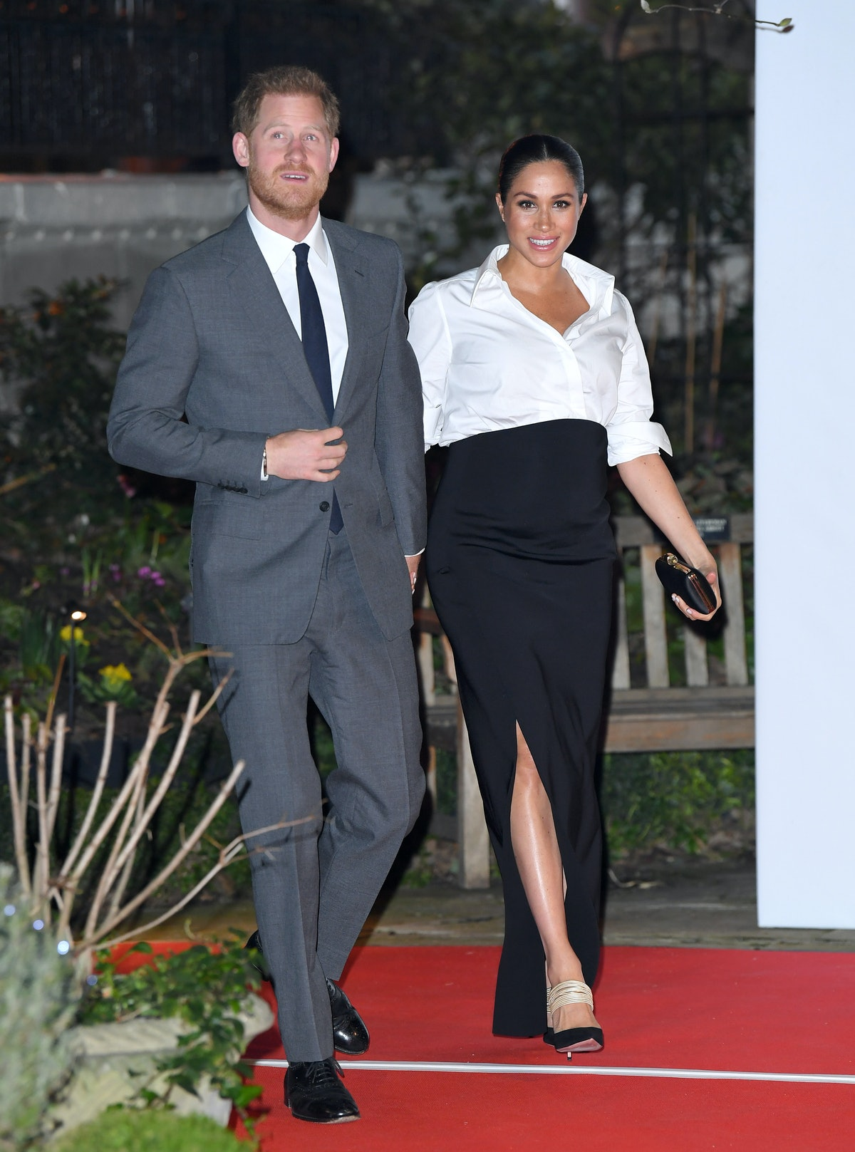 Meghan Markle wore Givenchy's white button-down shirt and black maxi skirt in February 2019.