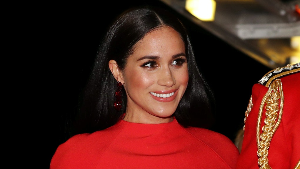 Meghan Markle steps out in a vibrant red dress.