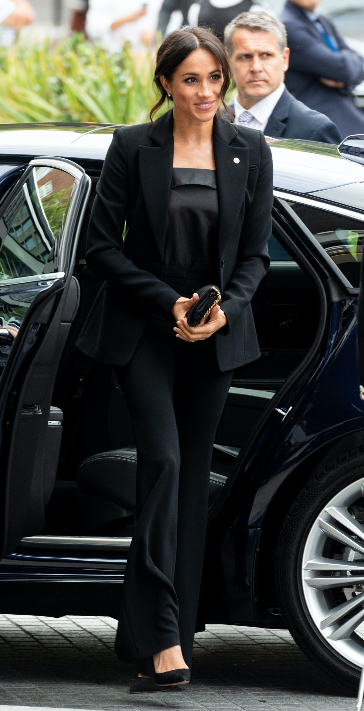 Meghan Markle wore a black silk camisole with a pantsuit for the WellChild Awards in 2018.
