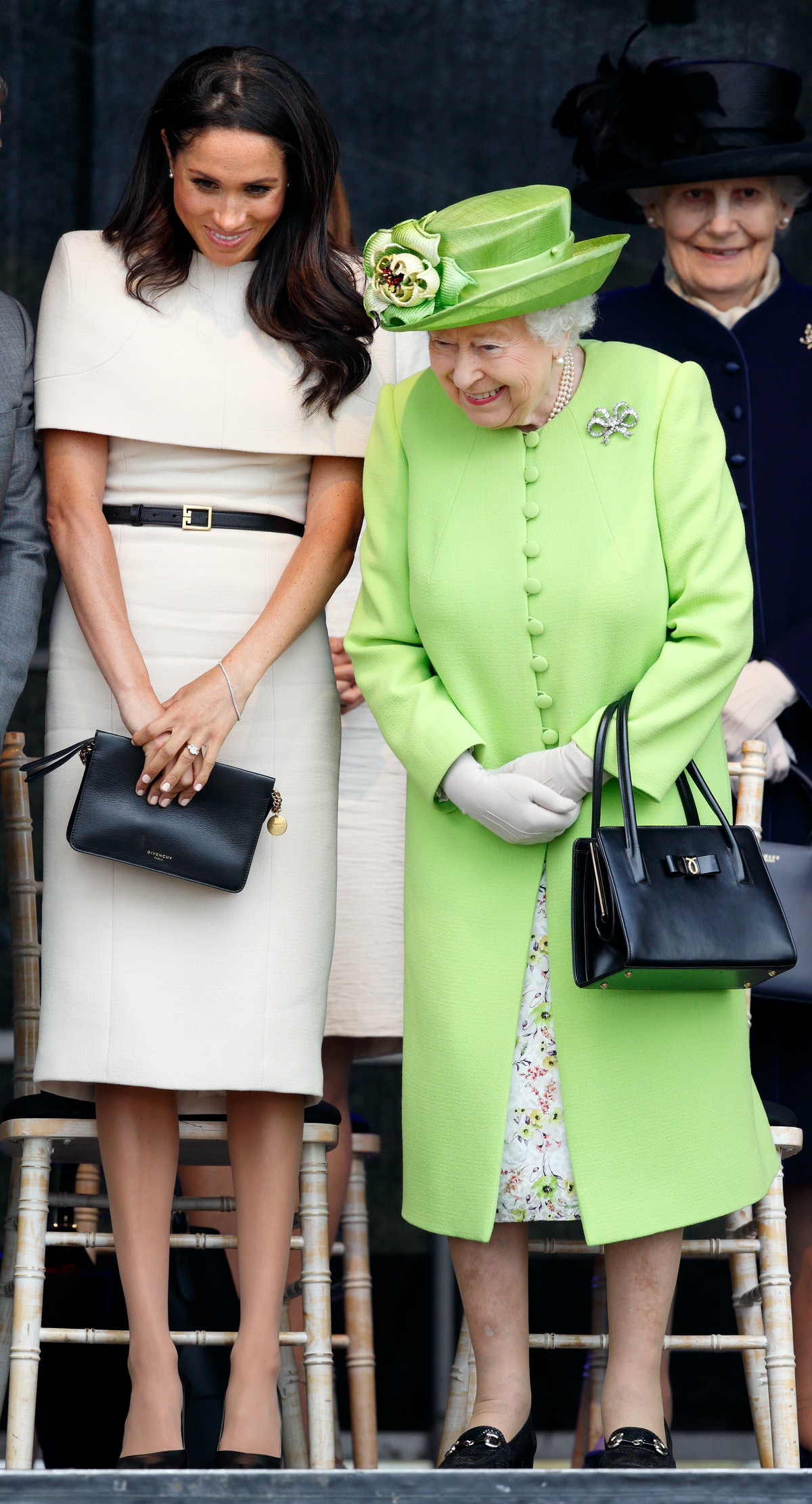 Meghan Markle wore an off-the-shoulder dress from Givenchy for a visit to Cheshire with the Queen in...