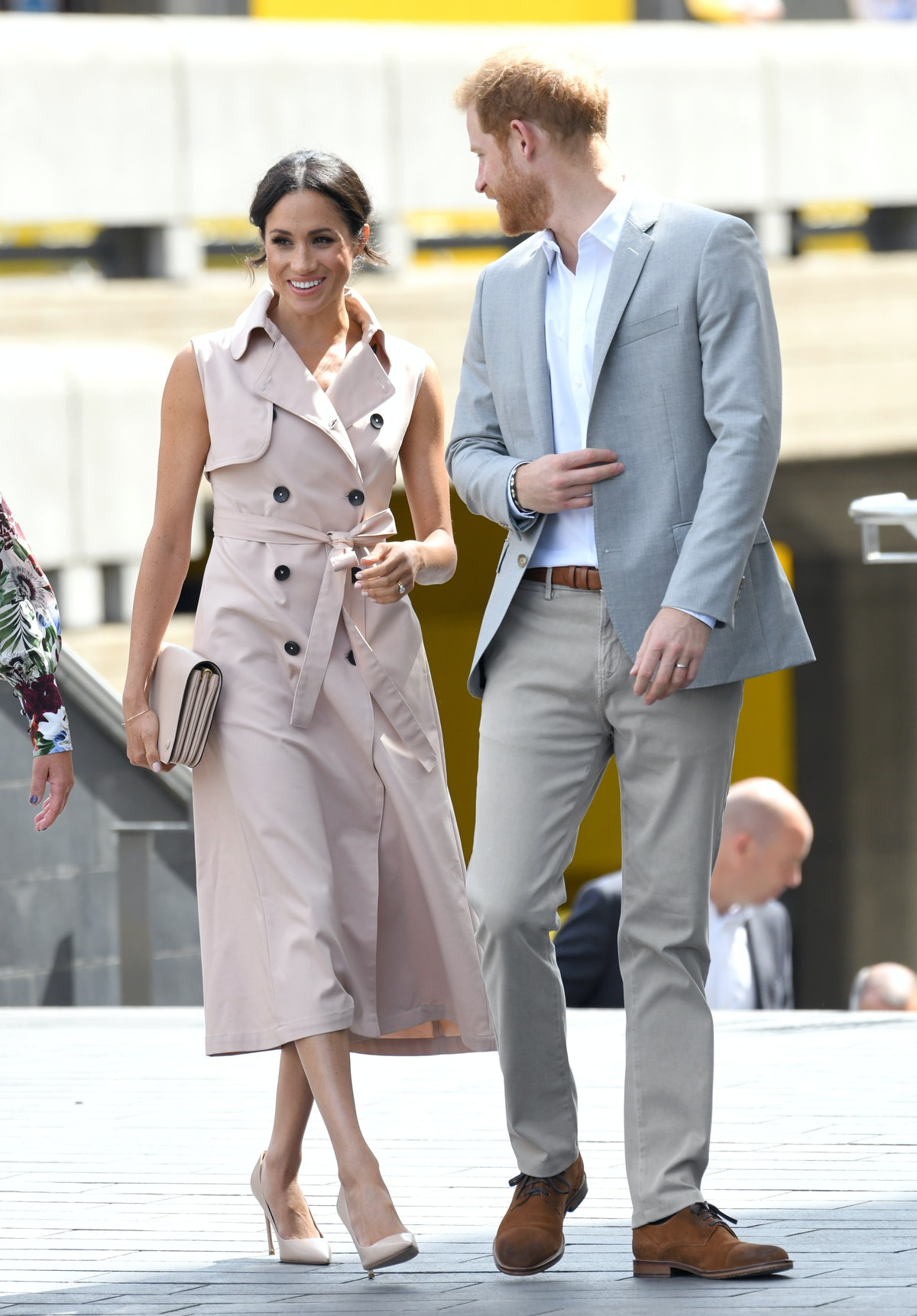 Meghan Markle styled a trench coat as a dress for the Nelson Mandela Centenary exhibition in Septemb...