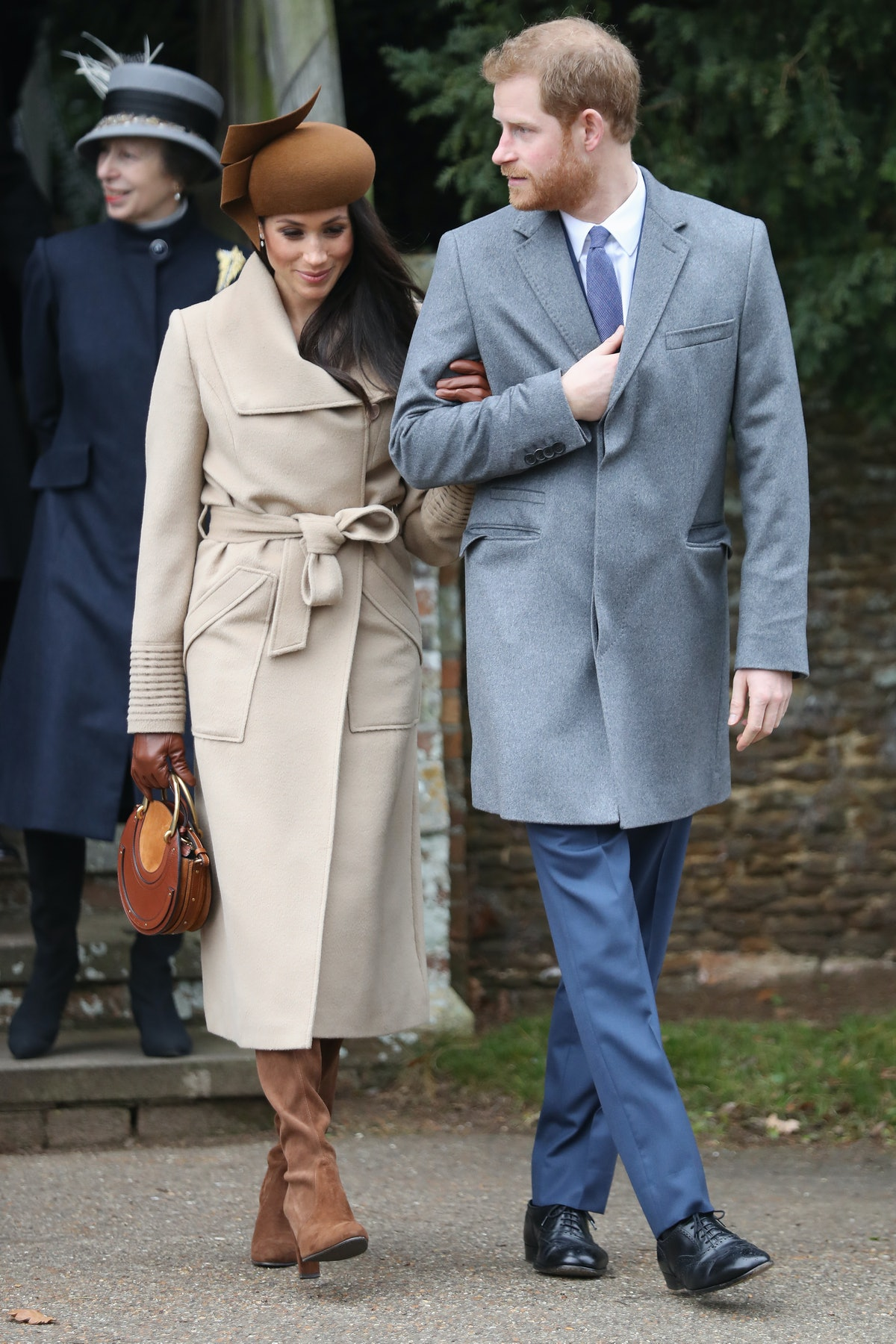 Meghan Markle wore a statement hat and knee-high bots from Stuart Weitzman in December 2018.
