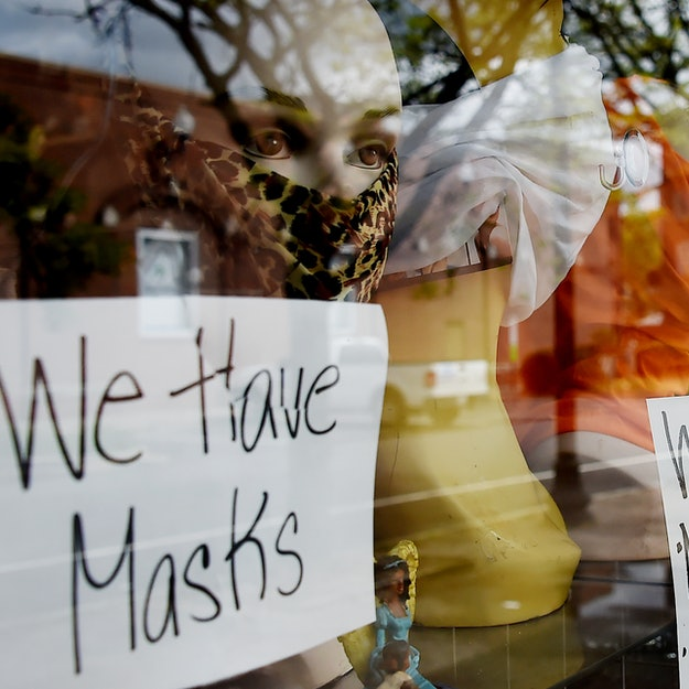 A Georgia storefront with mannequins wearing masks during the coronavirus pandemic. 3 Small Business Owners In Georgia Explain How They're Feeling About Reopening