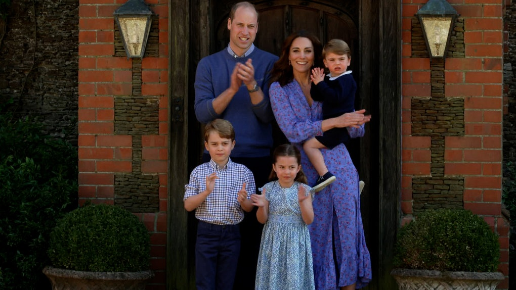Kate Middleton and Prince William take a family photo.