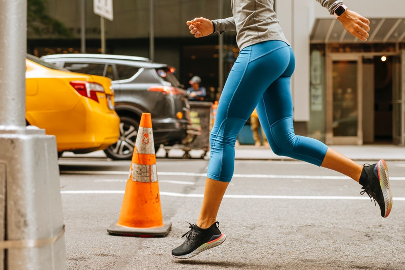 A woman runs on a busy new york city street. How do you prevent yeast infections? We asked ob-gyns o...