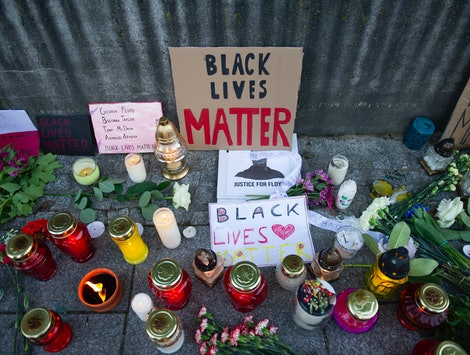 Signs and candles at a Black Lives Matter vigil. Before you go to a protest or share your footage from a protest, read this cyber security checklist.