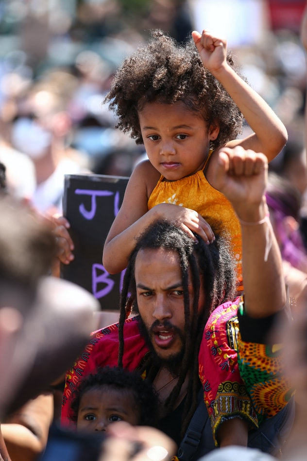 Father and children protest in London