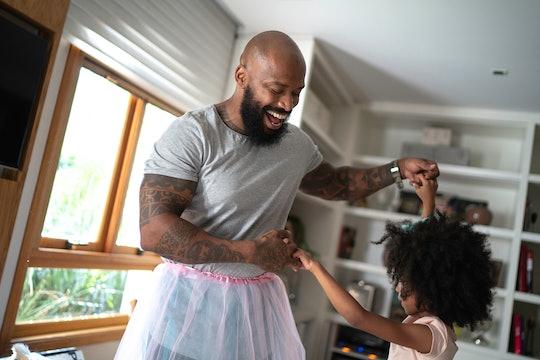 dad in tutu and daughter dancing