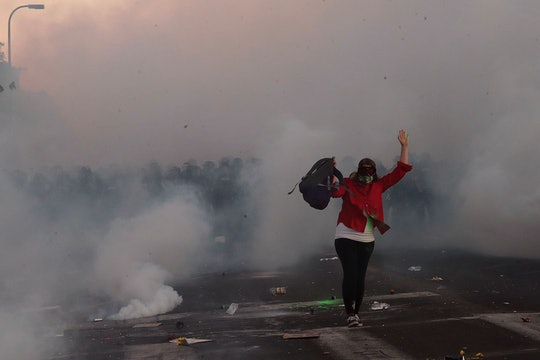 There is some evidence that tear gas could even cause miscarriages. So why are police still using it...
